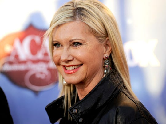 Olivia Newton-John, shown in 2013 arriving at the American Country Awards in Las Vegas.
