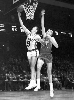 Knicks Hall of Famer Richie Guerin makes a layup in front of Nationals player Connie Dierking in a 1959 game.