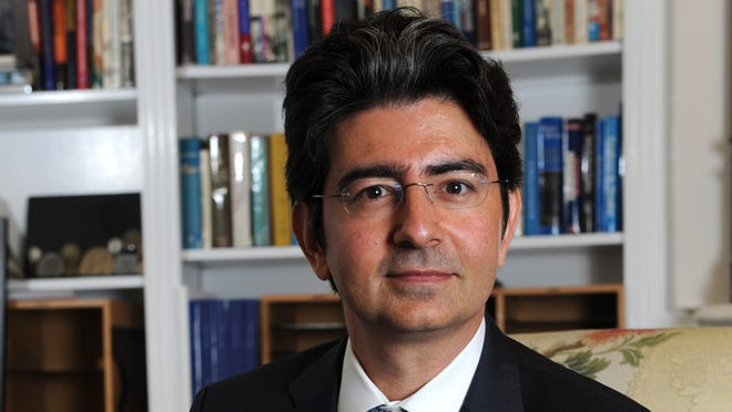 Profile of eBay founder, billionaire and philanthropist, Pierre Omidyar.