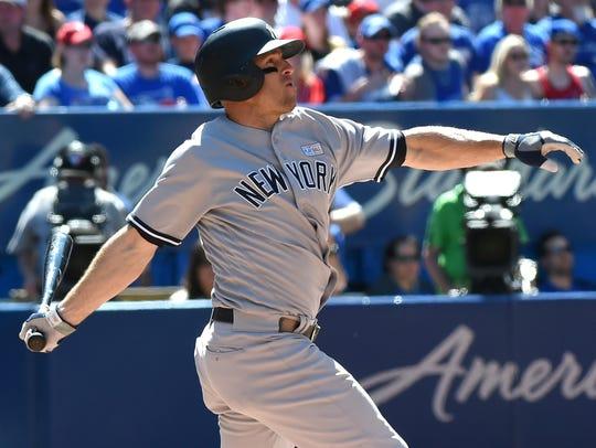 Yankees left fielder Brett Gardner (11) hits a home