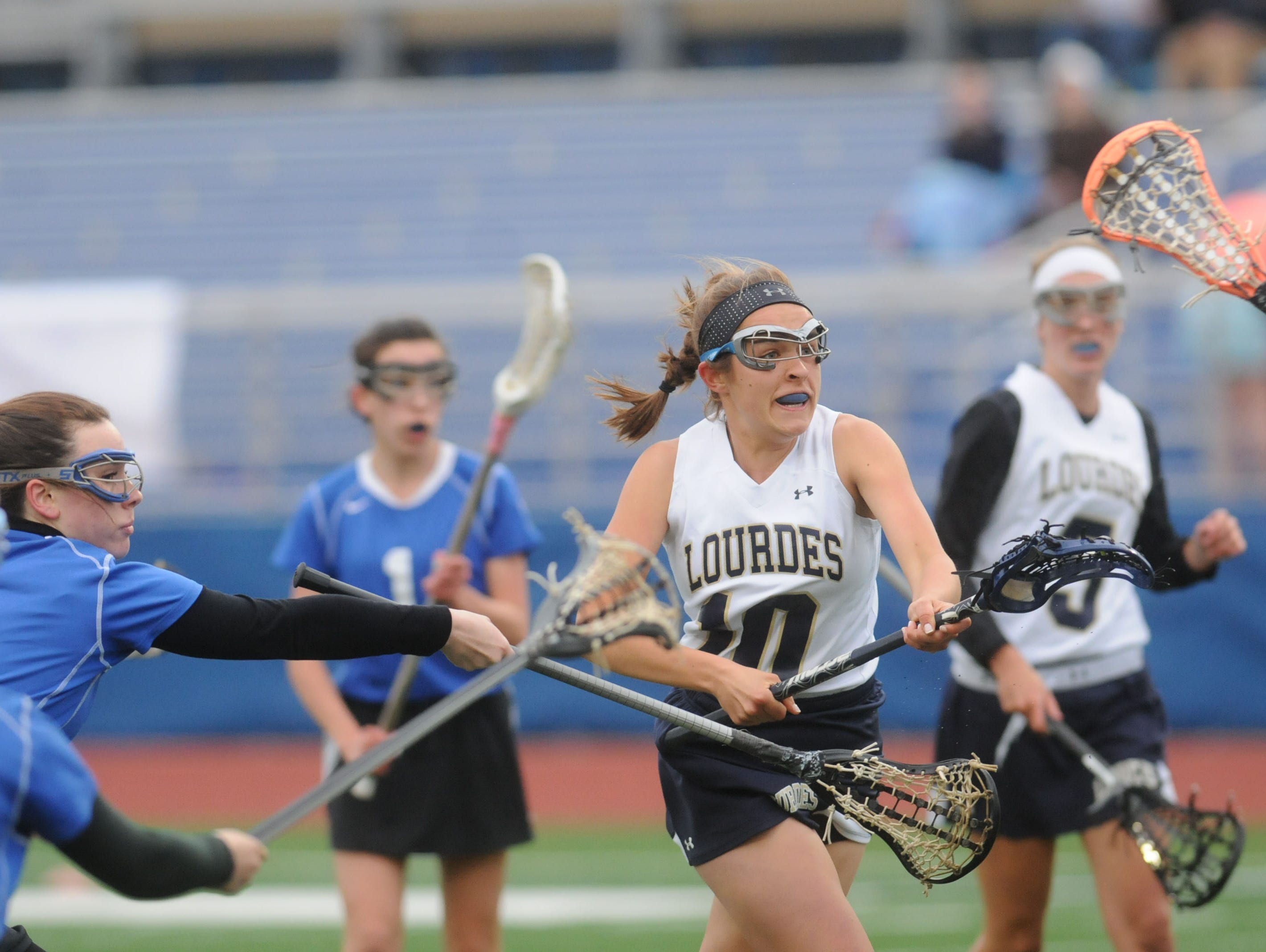 Lourdes' Cat Gallery, right, tries to score while Valley Central's Kelsey Giulotta, left, defends.