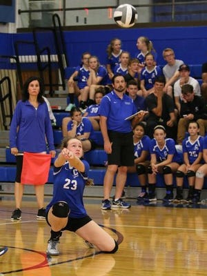 Chillicothe's Sophie Fulkerson kneels on the court as she digs a kill attempt against Unioto last fall. Fulkerson leads the Cavaliers, so far, this year, with 58 digs in seven matches.