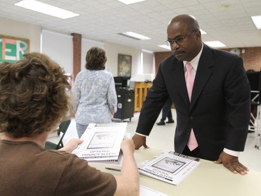 A file photo of James Sheppard voting at Christ the Good Shepherd Lutheran Church..