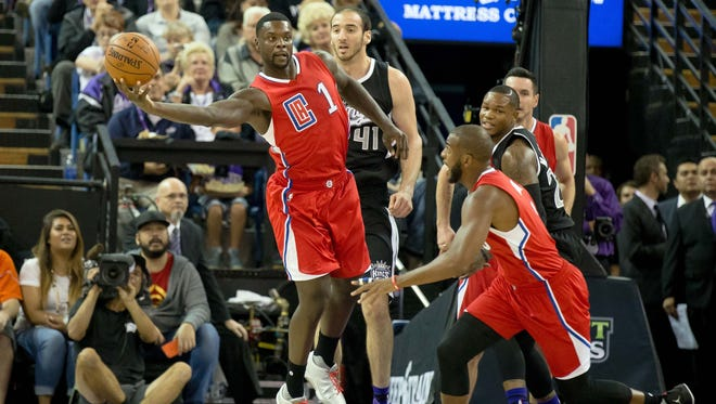 Los Angeles Clippers guard Lance Stephenson (1) looks to pass out the ball against Sacramento Kings center Kosta Koufos (41) during the first quarter at Sleep Train Arena.
