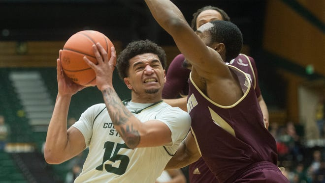 CSU guard Anthony Bonner works to get around Bobcats defense on his way to the basket during a game against Texas State at Moby Arena on Sunday, December 17, 2017.