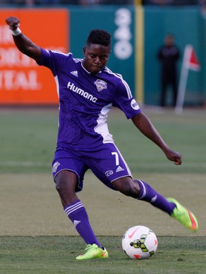 Louisville City's Kadeem Dacres, #7, shoots against Orlando City during their game at Slugger Field. Aug. 25, 2015