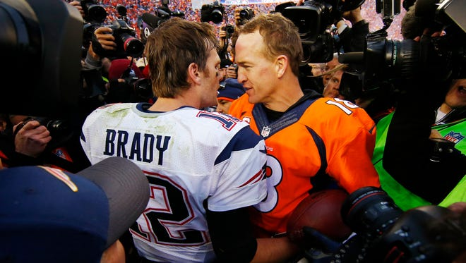 Jan 24, 2016: Denver Broncos quarterback Peyton Manning (18) greets New England Patriots quarterback Tom Brady (12) after the AFC Championship football game at Sports Authority Field at Mile High.