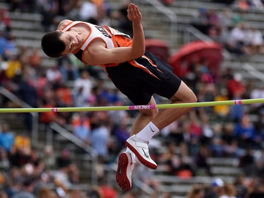 Dell Rapids' Mason Schmidt clears the bar in the Class A boys high jump during the 2016 SD State Track and Field Meet at Howard Wood Field on Saturday, May 28, 2016.