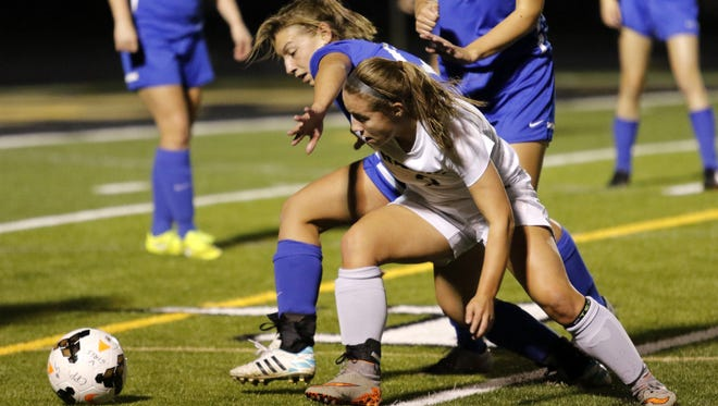 Corning's Hailey Bicknell, front, battles for possession of the ball during a win over Horseheads in the Section 4 Class AA semifinals last season.