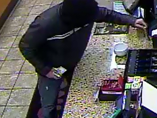 Surveillance photo of suspect in Dunkin' Donuts robbery
