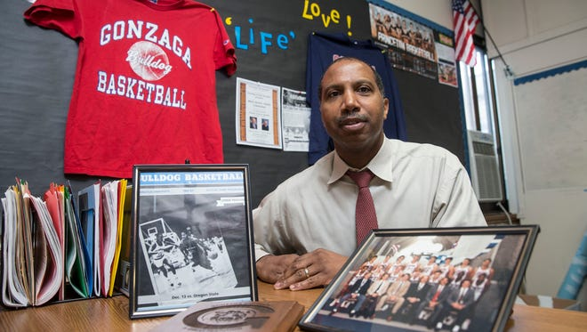 Lennie Parham, dean of students at Asbury Park High School, surrounded by Gonzaga basketball memorabilia in his office. He played guard for the Zags in the 1980s.
