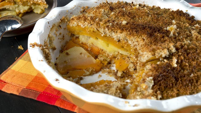 Parmesan sage crusted sweet potato gratin combines slices of Yukon gold with sweet potatoes in a layered, panko-topped dish.