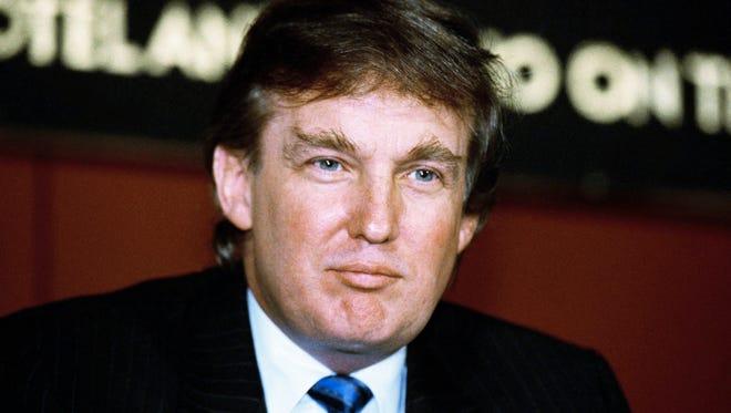 Shown in photo is Donald Trump  Nov. 20, 1990. (AP Photo/Mark Lennihan)