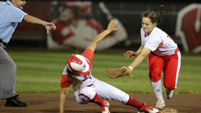 Thorp's Ellie Windl, left, beats the tag by Weyauwega-Fremont's Hannah Timm during a WIAA Division 4 state softball semifinal game Thursday in Madison.