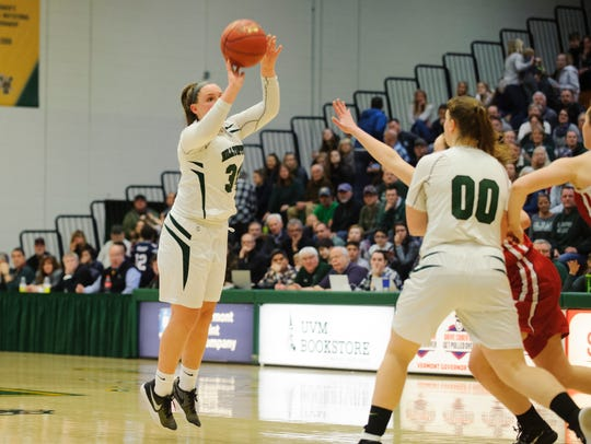 St. Johnsbury's Josie Choiniere (34) shoots a three