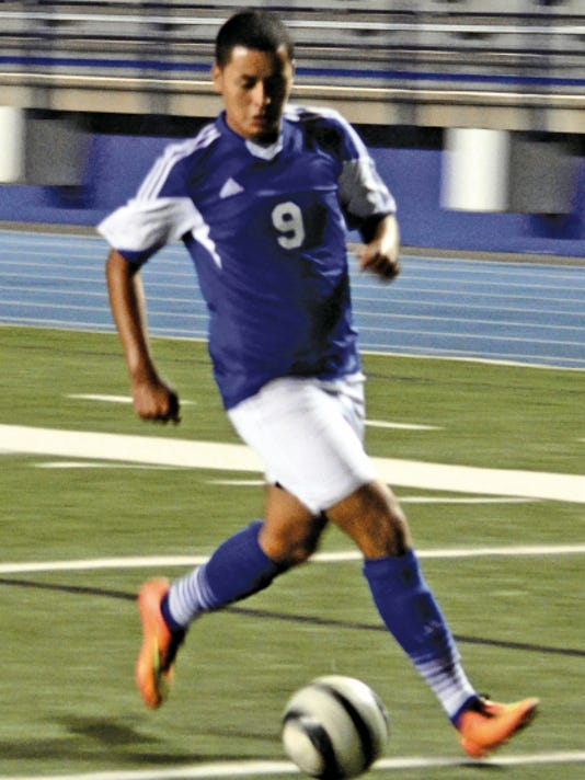 Matt Hollinshead — Current-Argus Cavemen senior forward Jesus Estrada dribbles down the left side toward the box in last Saturday's alumni match. Carlsbad opens the 2015 season 6 p.m. Thursday at home against Gadsden.