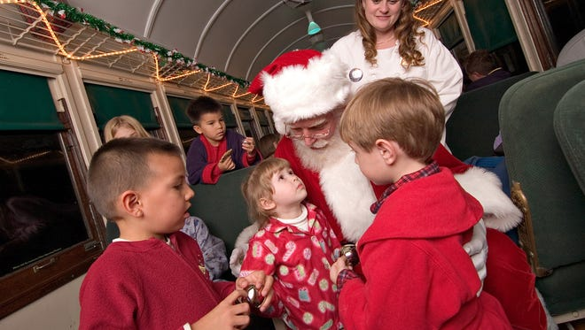 Santa shares stories and treats on The Polar Express in Williams.