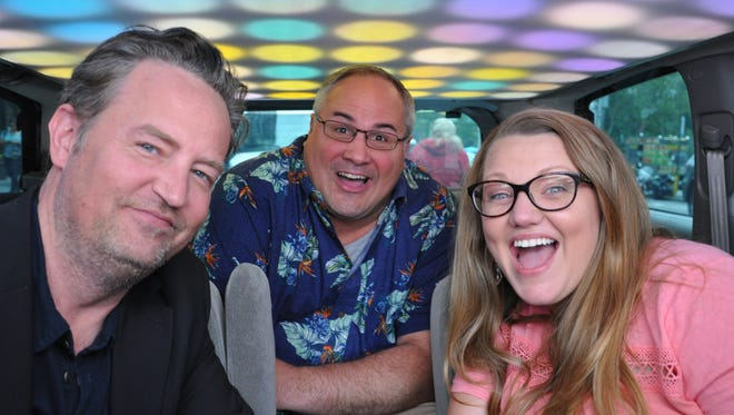 Matthew Perry, left, takes  a ride with contestants in the 'Cash Cab.'
