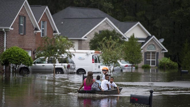 Pooler Fire Department boats residents of homes on Tappan Zee Drive after heavy flooding in the Pooler area due to Hurricane Matthew in October 2016.