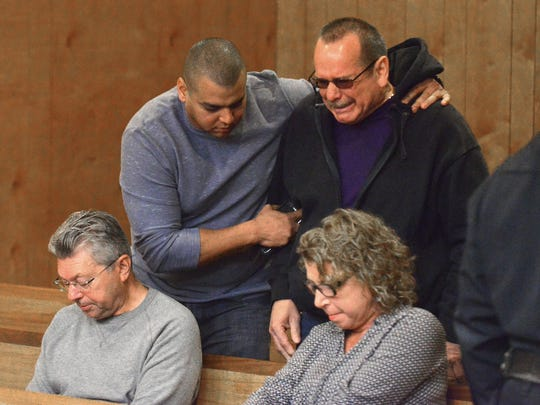 Members of Nicole Sierra's family react at Wednesday's arraignment of Clinton Degroat on a murder charge  A man who identified himself as Sierra's father told the judge that as a 62-year-old man, he now had to raise his grandson.