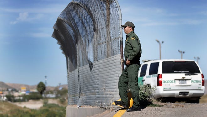 A Border Patrol agent stands guard Tuesday between El Paso and Juárez near Downtown. A House-Senate committee is examining the impact of legislation to boost the Department of Public Safety presence in South Texas and along the Rio Grande.