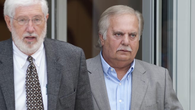 Businessman Cecil McCrory, right, is seen in this file photo leaveing the the U.S. Courthouse in Jackson, Miss.