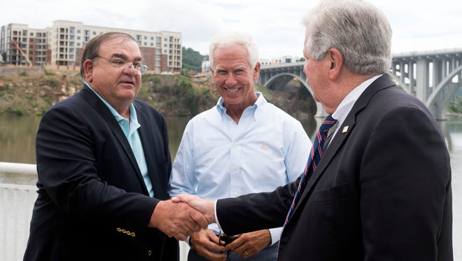 Lt. Gov. Randy McNally, right, greets restaurateurs Mike Chase, left, and Bo Connor during a news conference revealing the new vertical design of the Tennessee license and identification cards for people under 21 in July 2018.