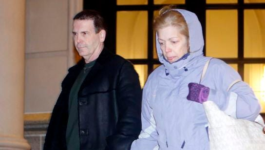 Mount Pleasant police Chief Brian Fanelli and his wife Sonja exit Federal Court Jan. 23, 2014 in White Plains. Fanelli was freed on $50,000 bail after appearing in federal court to face child pornography charges, hours after federal agents raided his Mahopac home and seized computers containing more than 120 files of children as young as 7 years old engaging in sex acts.