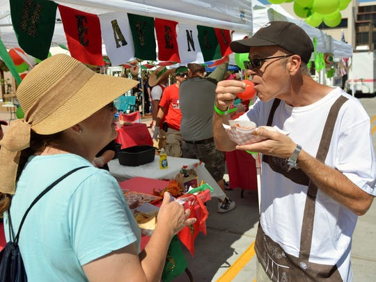 Sylvia and Kent Waggoner from El Paso sample some of the salsas at last year's SalsaFest held at Plaza de Las Cruces. The event returns this year as a one-evening street festival.