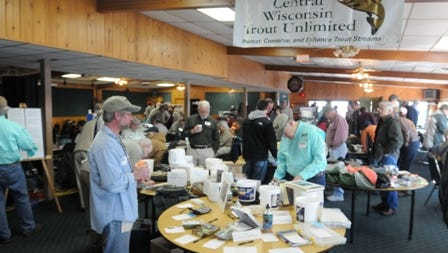 Hundreds of people attended the Central Wisconsin Annual TroutFest 12 held at theFin and Feather in Winneconne February 25, 2012. There were fly tiers, many seminars, youth fly tying, raffles, fishing rummage sale and vendors that had displays during the event.