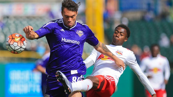 Louisville City FC's Cameron Lancaster has the ball kicked away by New York City Red Bull II's defender Noah Powder in the second half in Saturday's match. Louisville lost 2-0.