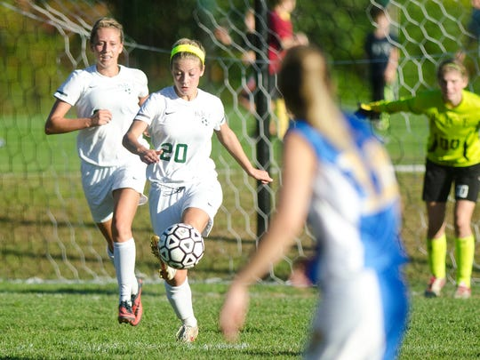 Rice midfielder Riley Mitiguy (20) controls a ball in the box during a game against Milton last season.