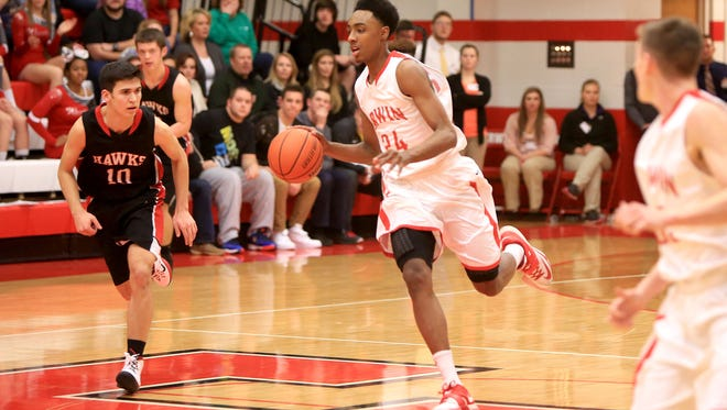 Erwin senior Malik Moore committed to play college basketball for USC Upstate on Saturday.