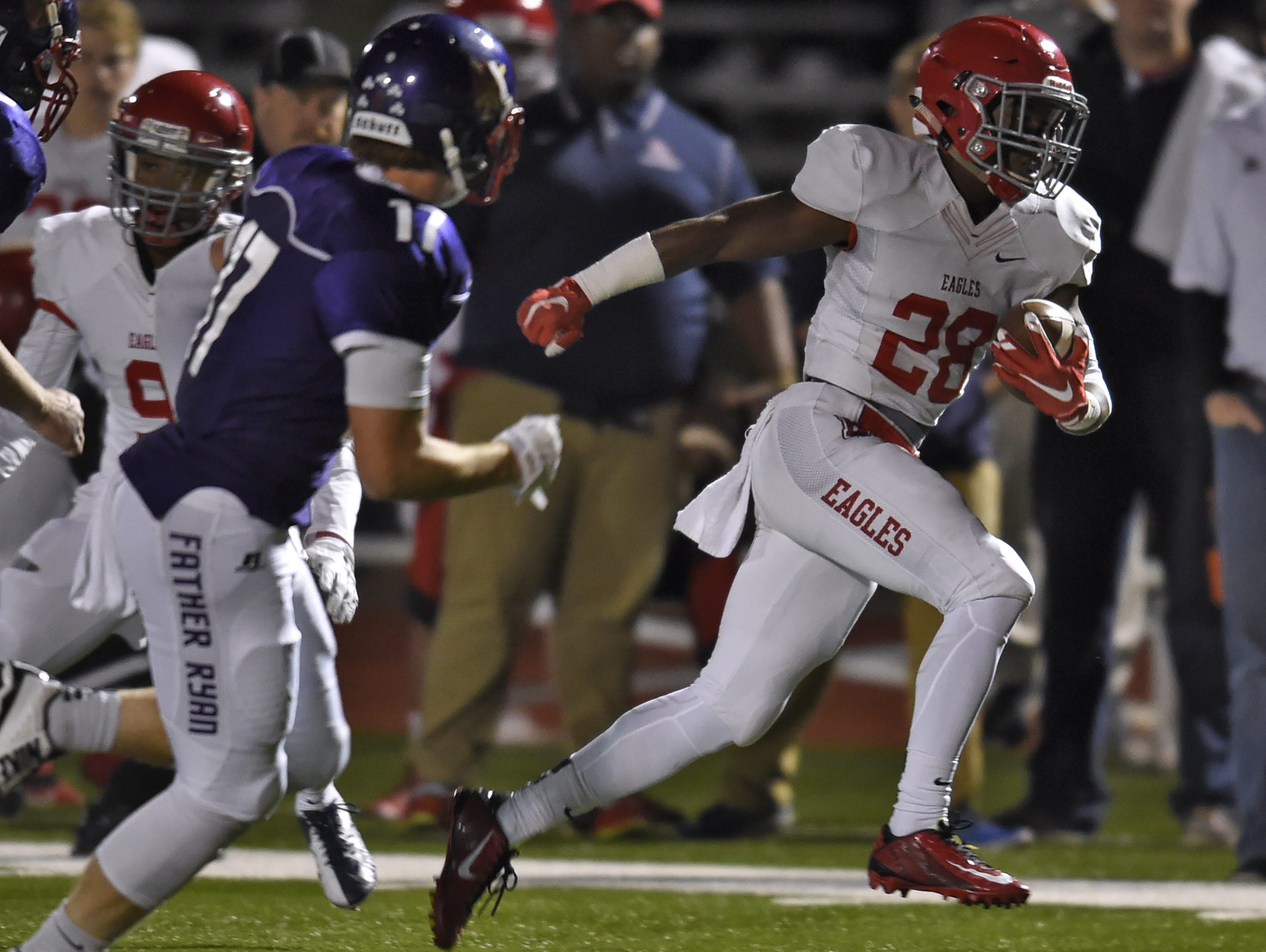 Brentwood Academy running back Daniel Taylor (28) races past the Father Ryan defense during last week's win.