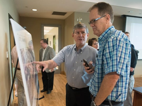 Dave Hemphill, project manager for the Bluffs, left,