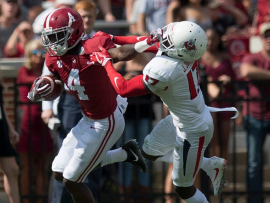 Alabama wide receiver Jerry Jeudy (4) is defended by