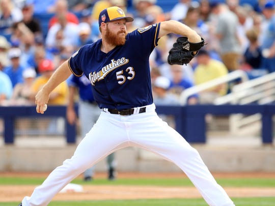 Brandon Woodruff will open in the bullpen and then is expected to slide into the fifth spot in the Brewers rotation.