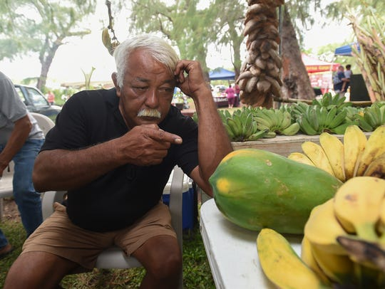 John Aguon points to a papaya during the 9th Annual