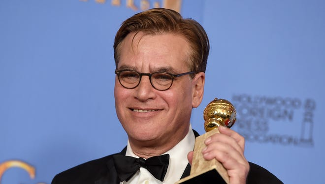 Aaron Sorkin with his Golden Globe, maybe after pinching himself.