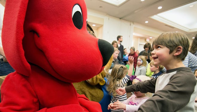 Caden Huntley reacts to meeting Clifford the Big Red Dog during the 2014 One Book Two Book Festival, a celebration of children's literature.