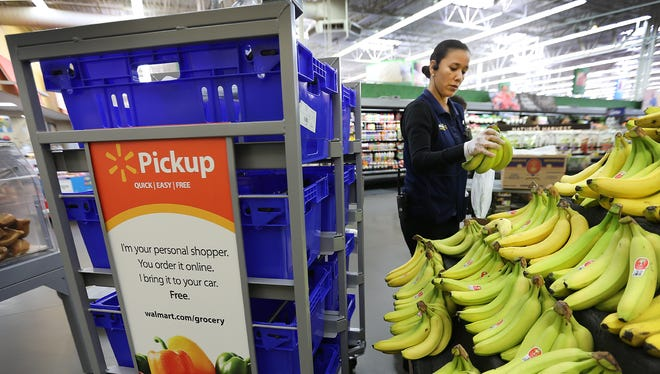 Wal-Mart department manager Erika Delgado shops to demonstrate the store's new online ordering and pickup service Wednesday at the 12236 Montana Ave. location. The service is available at three El Paso-area stores.