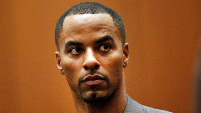 In this Feb. 20, 2014, file photo, former NFL safety Darren Sharper appears in Los Angeles Superior Court in Los Angeles. The two Louisiana co-defendants in the drug and rape case that brought down one-time NFL star Sharper are set for sentencing in federal court in New Orleans. Erik Nunez, a former restaurant worker, and Brandon Licciardi a former suburban sheriff's deputy, pleaded guilty to state and federal charges earlier this year.