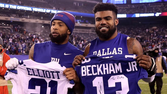 Cowboys rookie running back Ezekiel Elliott, right, and Giants receiver Odell Beckham Jr. exchange jerseys after the game at MetLife Stadium on December 11, 2016 in East Rutherford, New Jersey.