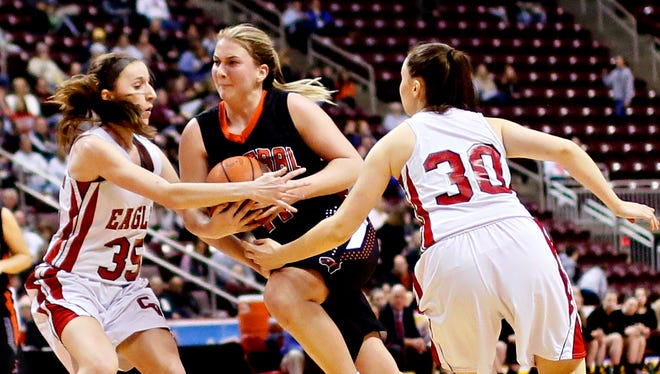 Central York's Nikki Valencik (center) tries to split a pair of Cumberland Valley defenders during the District 3 6-A semifinals last season. Valencik is one of four returning starters coming back for the Panthers in 2017-18.