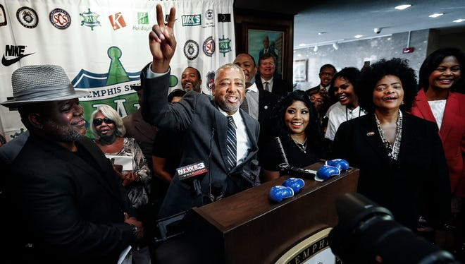 Memphis native and boxing promoter Sam Watson (middle) salutes the crowd gathered during a ceremony at City Hall, where he received a key to the city Thursday morning. Watson, is currently promoting the mega fight of Floyd Mayweather against Conner McGregor later this month.