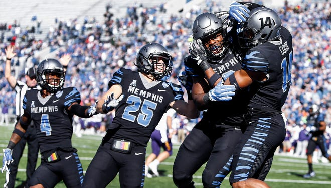 Memphis defender Jonathan Cook (right) celebrates with teammates after returning a interception for a touchdown against ECU during first quarter at the Liberty Bowl Memorial Stadium in Memphis, Tenn., Saturday, November 25, 2017.