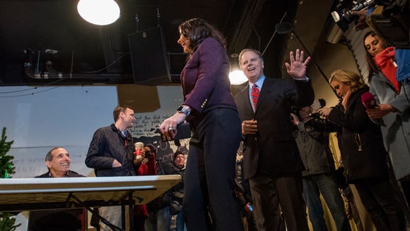 U.S. Senate candidate Doug Jones arrives to vote with
