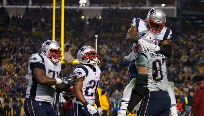 Rob Gronkowski of the New England Patriots celebrates with teammates after catching a pass for a two-point conversion in the fourth quarter.
