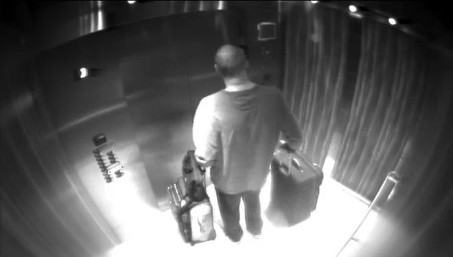 In this Sept. 25, 2017, security camera image released by MGM Resorts, Stephen Paddock stands with his luggage in an elevator at the Mandalay Bay hotel in Las Vegas. The newly released video shows the man who killed 58 people on the Las Vegas Strip moving around a casino before the attack, gambling, bringing suitcases into his room at Mandalay Bay but doing nothing that would obviously raise suspicions.