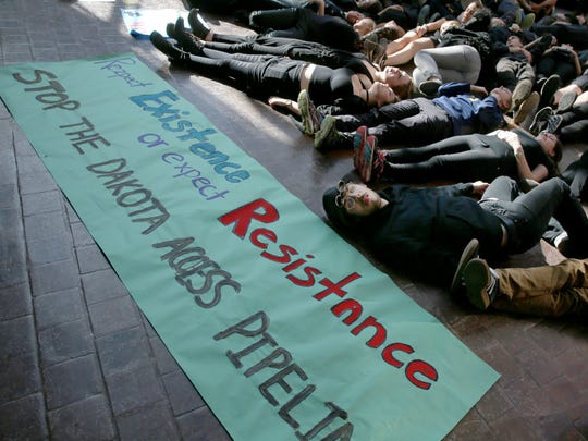 """University of Rochester junior David VanderMeer, Boulder, Colorado, bottom right, joins with nearly 70 others during the """"Human Oil Spill"""" held at the University of Rochester Tuesday, Nov. 15, 2016. The protest was in support of those protesting the Dakota Access Pipeline in North Dakota."""